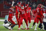 Fresno State defensive back Evan Williams holds up the ball after a fumble by Nevada during the first half of an NCAA college football game in Fresno, Calif., Saturday, Nov. 23, 2019. (AP Photo/Gary Kazanjian)
