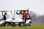President Donald Trump sits in a golf cart as he plays golf at Trump National Golf Club, Friday, Nov. 27, 2020, in Sterling, Va. (AP Photo/Alex Brandon)