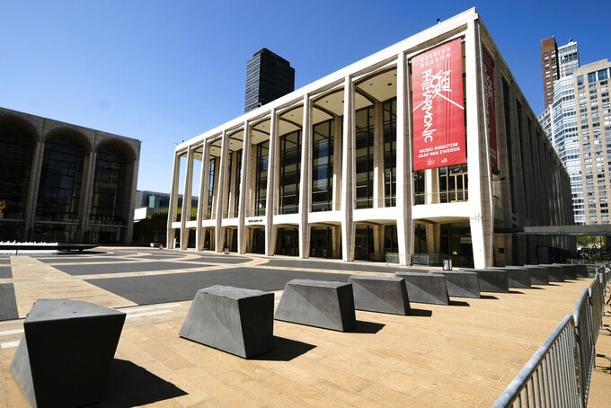 FILE - This May 12, 2020 file photo shows David Geffen Hall at Lincoln Center, closed during COVID-19 lockdown, in New York. The New York Philharmonic has launched an on-demand video and audio streaming service Monday called NYPhil+ that is available for $50 annually or $4.99 monthly.  (Photo by Evan Agostini/Invision/AP, File)
