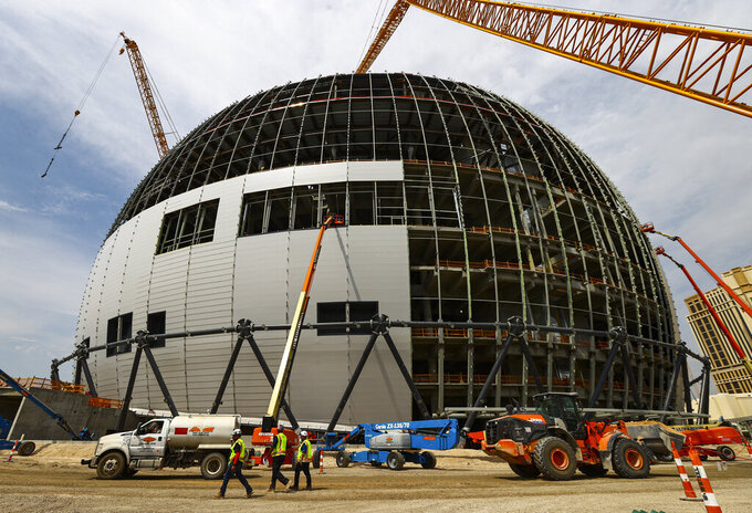 """Construction continues during a tour of the Madison Square Garden Sphere at The Venetian in Las Vegas on Thursday, June 17, 2021. Officials planned a """"topping out"""" ceremony Friday after providing a media tour Thursday inside the domed frame of the venue. It's set for completion in 2023. (Chase Stevens /Las Vegas Review-Journal via AP)"""