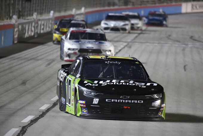 Ross Chastain heads into Turn 1 during NASCAR Xfinity auto race at Texas Motor Speedway in Fort Worth, Texas, Saturday, Nov. 2, 2019. (AP Photo/Larry Papke)