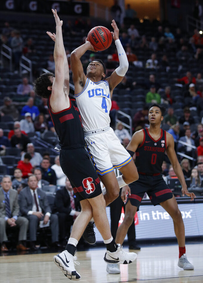 UCLA's Jaylen Hands shoots over Stanford's Cormac Ryan during the first half of an NCAA college basketball game in the first round of the Pac-12 men's tournament, Wednesday, March 13, 2019, in Las Vegas. (AP Photo/John Locher)
