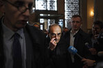French Cardinal Philippe Barbarin, center, arrives at the Lyon courtroom, central France, for his appeal trial Thursday, Nov.28, 2019 in Lyon. The French cardinal's career is on the line as an appeals court decides whether to uphold his conviction for covering up sexual abuse of children. (AP Photo/Laurent Cipriani)