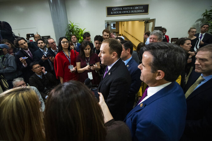 Rep. Lee Zeldin, R-N.Y., from center to right, with Rep. John Ratcliffe, R-Texas and Rep. Jim Jordan, R-Ohio, speaks to reporters at the Capitol in Washington, Monday, Jan. 27, 2020, during the impeachment trial of President Donald Trump on charges of abuse of power and obstruction of Congress. (AP Photo/Manuel Balce Ceneta)