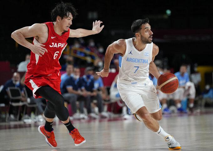 Argentina's Facundo Campazzo (7) drives around Japan's Makoto Hiejima (6) during men's basketball preliminary round game at the 2020 Summer Olympics, Sunday, Aug. 1, 2021, in Saitama, Japan. (AP Photo/Eric Gay)