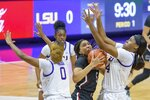 South Carolina forward Victaria Saxton (5) battles under the basket against LSU guard Destini Lombard (4) during an NCAA cpllege basketball game in Baton Rouge, La., Sunday, Jan. 24, 2021. (AP Photo/Matthew Hinton)