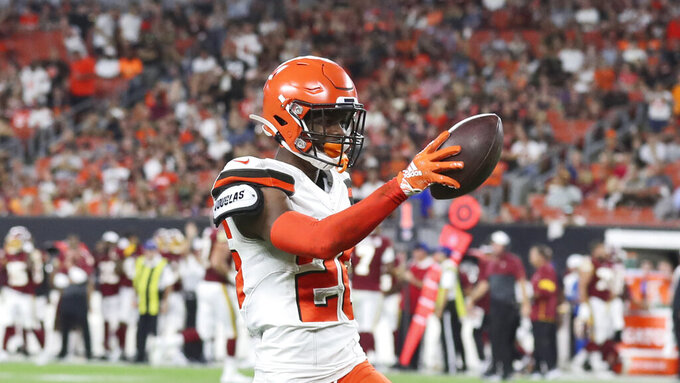 Cleveland Browns cornerback Greedy Williams celebrates after an interception during the first half of the team's NFL preseason football game against the Washington Redskins, Thursday, Aug. 8, 2019, in Cleveland. (AP Photo/Ron Schwane)