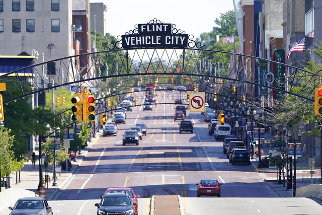 A view of Saginaw Avenue in downtown Flint, Mich, Thursday, Aug. 20, 2020. Michigan Gov. Gretchen Whitmer says a proposed $600 million deal between the state of Michigan and Flint residents harmed by lead-tainted water is a step toward making amends. Officials announced the settlement Thursday, which must be approved by a federal judge. (AP Photo/Carlos Osorio)