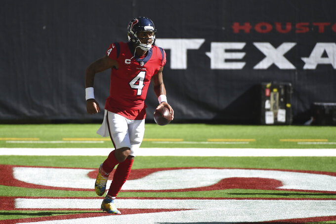 Houston Texans quarterback Deshaun Watson (4) runs through the end zone after scoring a touchdown against the Indianapolis Colts during the first half of an NFL football game Sunday, Dec. 6, 2020, in Houston. (AP Photo/Eric Christian Smith)