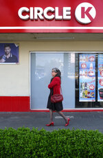 A woman walks past a Circle K convenience store in Mexico City, Thursday, July 18, 2019. Circle K Mexico is apologizing for an ad on