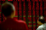 Chinese investors monitor stock prices at a brokerage house in Beijing, China, Thursday, Aug. 9, 2018. (AP Photo/Mark Schiefelbein)
