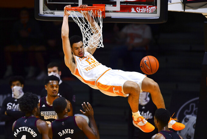 Tennessee forward Olivier Nkamhoua dunks during the team's NCAA college basketball game against Mississippi State on Tuesday, Jan. 26, 2021, in Knoxville, Tenn. (Brianna Paciorka/Knoxville News Sentinel via AP, Pool)