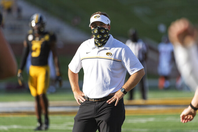 Missouri head coach Eliah Drinkwitz watches his team warm up before an NCAA college football game against Alabama, Saturday, Sept. 26, 2020, in Columbia, Mo. (AP Photo/L.G. Patterson)