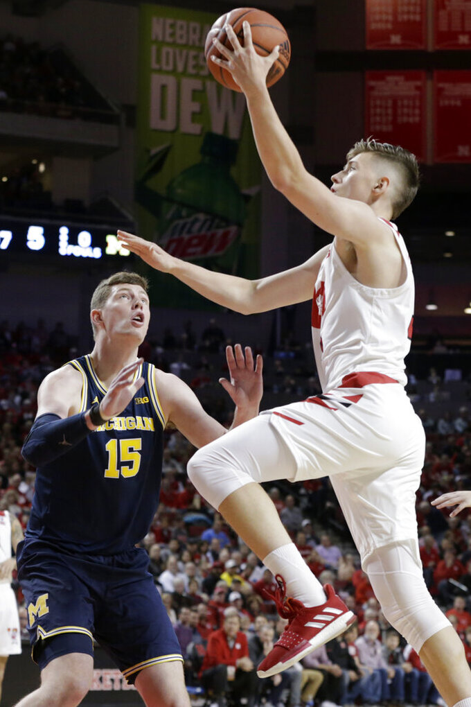 Nebraska's Thorir Thorbjarnarson goes to the basket against Michigan's Jon Teske (15) during the first half of an NCAA college basketball game in Lincoln, Neb., Tuesday, Jan. 28, 2020. (AP Photo/Nati Harnik)
