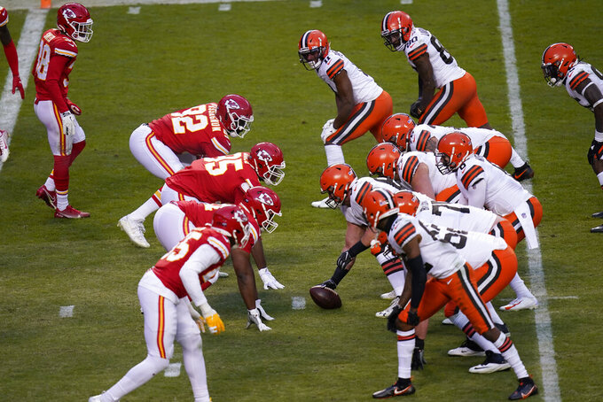 Players get set on the line of scrimmage during the second half of an NFL divisional round football game between the Kansas City Chiefs and the Cleveland Browns, Sunday, Jan. 17, 2021, in Kansas City. (AP Photo/Orlin Wagner)