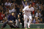 Boston Red Sox's Rafael Devers watches his three-run home run in front of Minnesota Twins catcher Jason Castro during the fifth inning of a baseball game at Fenway Park, Tuesday, Sept. 3, 2019, in Boston. (AP Photo/Elise Amendola)