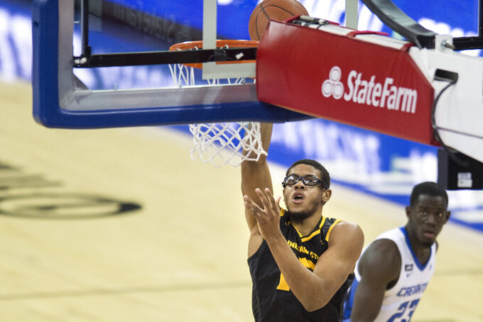Kennesaw State's Alex Peterson scores against Creighton during the first half of an NCAA college basketball game in Omaha, Neb., Friday, Dec. 4, 2020. (AP Photo/Kayla Wolf)