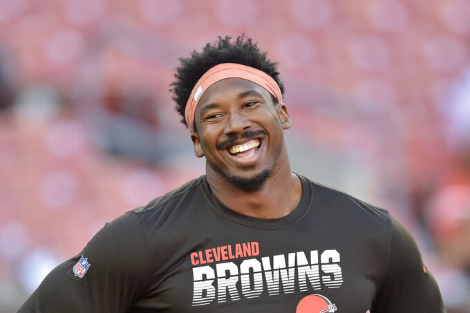 "FILE - In this Aug. 29, 2019, file photo, Cleveland Browns defensive end Myles Garrett smiles before an NFL preseason football game against the Detroit Lions, in Cleveland. The Browns star defensive end has been chosen as the new captain of the NFL Waterboys program, which is committed to bringing clean water to needy East African communities. Garrett is taking over the role previously held by Chris Long, who retired after 11 seasons.  ""I am thrilled to be the Waterboys NFL captain and continue my work in ensuring that people have access to safe water,"" Garrett said. (AP Photo/David Richard, File)"