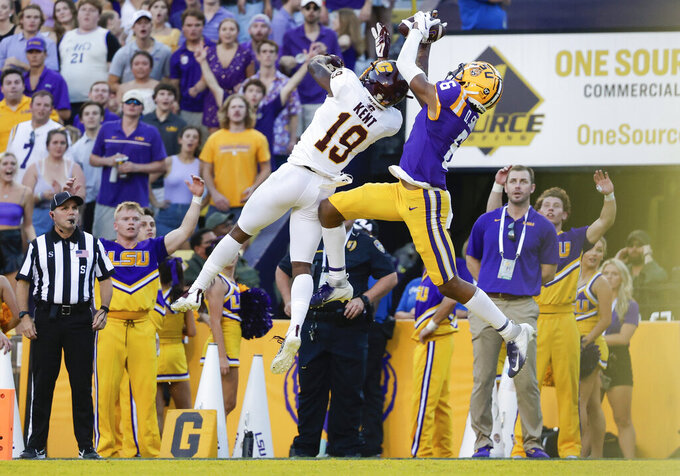 LSU wide receiver Deion Smith (6) catches a pass for a touchdown next to Central Michigan defensive back Donte Kent (19) during the first quarter of an NCAA college football game in Baton Rouge, La,. Saturday, Sept. 18, 2021. (AP Photo/Derick Hingle)