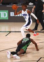 Orlando Magic forward Wes Iwundu (25) tries to control the ball as Boston Celtics forward Semi Ojeleye (37) falls to the floor during the first half of an NBA basketball game Sunday, Aug. 9, 2020, in Lake Buena Vista, Fla. (Kim Klement/Pool Photo via AP)