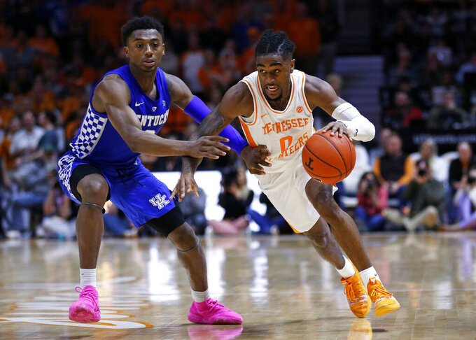Tennessee guard Jordan Bone (0) drives against Kentucky guard Ashton Hagans (2) during the second half of an NCAA college basketball game Saturday, March 2, 2019, in Knoxville, Tenn. Tennessee won 71-52. (AP Photo/Wade Payne)