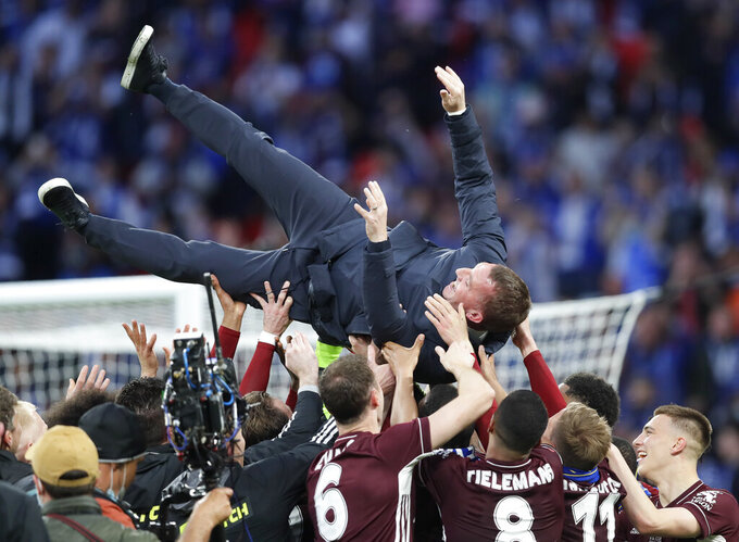 Leicester's manager Brendan Rodgers is thrown into the air by his players as they celebrate at the end of the FA Cup final soccer match between Chelsea and Leicester City at Wembley Stadium in London, England, Saturday May 15, 2021. Leicester won the match 1-0. (AP Photo/Kirsty Wigglesworth, Pool)