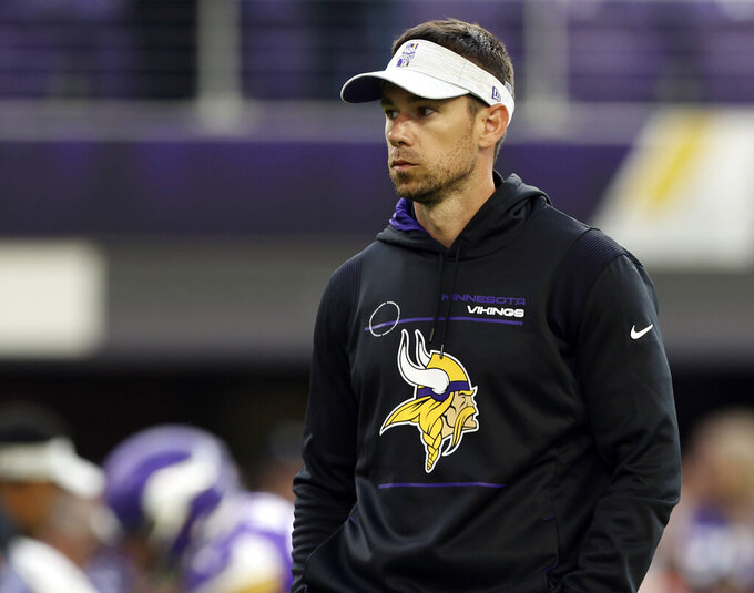 FILE - In this Aug. 21, 2021, file photo, Minnesota Vikings offensive coordinator Klint Kubiak watches warmups prior to an NFL preseason football game against the Indianapolis Colts in Minneapolis. Three games into his debut as the play caller, Kubiak is clicking with quarterback Kirk Cousins and making a seamless transition from his now-retired father. (AP Photo/Stacy Bengs, File)