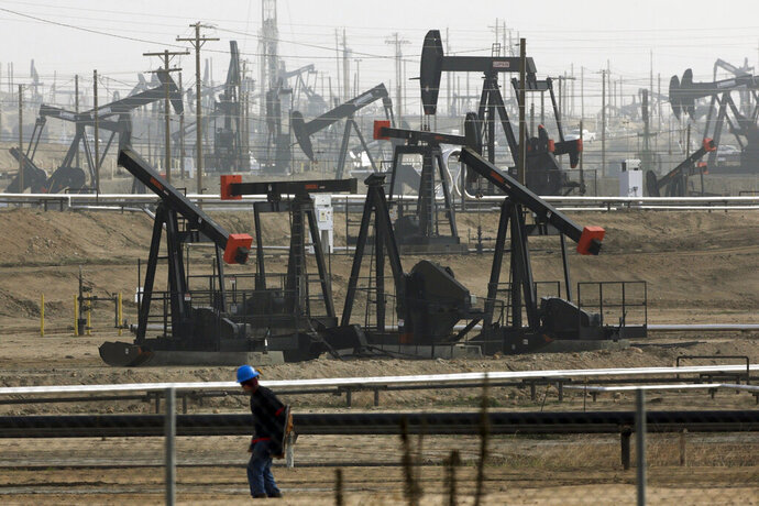 FILE - This Jan. 16, 2015, file photo shows pumpjacks operating at the Kern River Oil Field, in Bakersfield, Calif. Some Democratic presidential hopefuls are calling for fracking bans. It may play well with some of the party's base, but it could be risky. (AP Photo/Jae C. Hong, File)