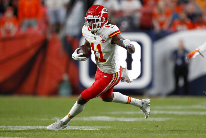 Kansas City Chiefs wide receiver Demarcus Robinson (11) runs the ball against the Denver Broncos during the first half of an NFL football game, Thursday, Oct. 17, 2019, in Denver. (AP Photo/David Zalubowski)