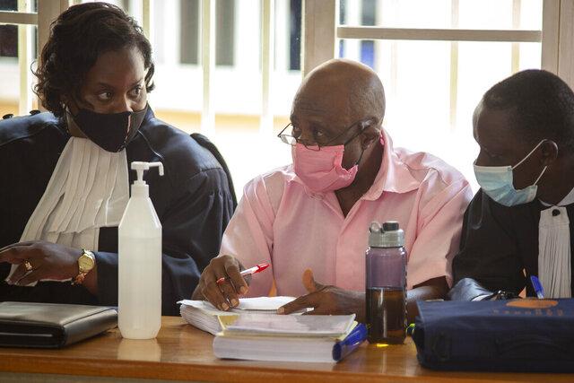 Paul Rusesabagina, center, whose story inspired the film