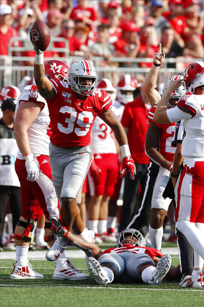 Ohio State linebacker Malik Harrison, left, celebrates after recovering a fumble against Miami (Ohio) during the first half of an NCAA college football game Saturday, Sept. 21, 2019, in Columbus, Ohio. (AP Photo/Jay LaPrete)