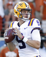 FILE - In this Sept. 7, 2019, file photo, LSU quarterback Joe Burrow (9) looks for a receiver during the second half of an NCAA college football game against Texas, in Austin, Texas. The SEC hasn't had a quarterback picked in the first round of the NFL draft since Johnny Manziel in 2014, and the league has never had more than one quarterback taken in the first round. It appears that's about to change, as Tua Tagovailoa, Joe Burrow and possibly Jake Fromm could make the next draft the best ever for SEC quarterbacks. (AP Photo/Eric Gay, File)