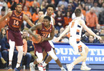 Virginia Tech guard Tyrece Radford (23) moves past Syracuse's Joseph Girard III during an NCAA college basketball game Tuesday, Jan. 7, 2020, in Syracuse, N.Y. (Dennis Nett/The Post-Standard via AP)