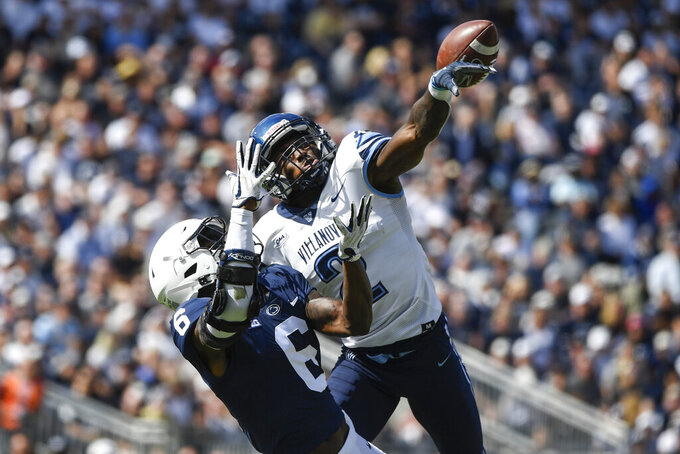 Villanova defensive back Denzel Williams (2) breaks up a pass intended for Penn State wide receiver Cam Sullivan-Brown (6) during an NCAA college football game in State College, Pa., on Saturday, Sept.25, 2021. Penn State defeated Villanova 38-17. (AP Photo/Barry Reeger)