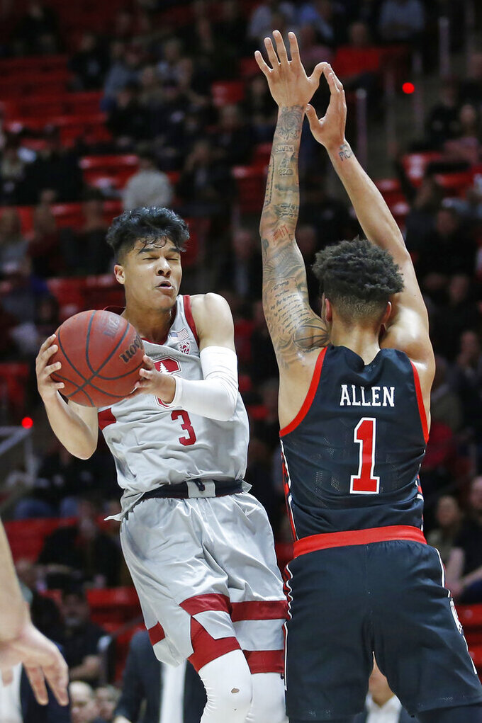 Stanford guard Tyrell Terry (3) goes to the basket as Utah forward Timmy Allen (1) defends in the first half during an NCAA college basketball game Thursday, Feb. 6, 2020, in Salt Lake City. (AP Photo/Rick Bowmer)