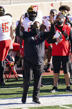 Maryland head coach Michael Locksley signals a field goal during the first half of an NCAA college football game against Indiana, Saturday, Nov. 28, 2020, in Bloomington, Ind. (AP Photo/Darron Cummings)