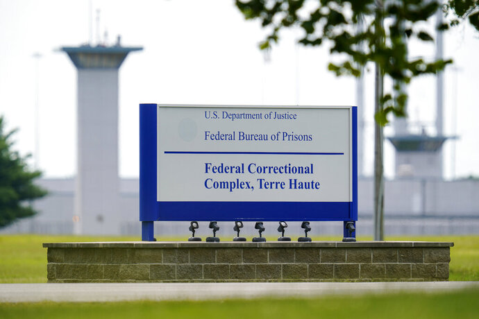 "FILE - This Aug. 28, 2020, file photo shows the federal prison complex in Terre Haute, Ind. The Justice Department is quietly amending its execution protocols, no longer requiring federal death sentences to be carried out by lethal injection and clearing the way for other methods like firing squads and poison gas. The amended rule, published Friday, Nov. 27, in the Federal Register, allows the U.S. government to conduct executions by lethal injection or use ""any other manner prescribed by the law of the state in which the sentence was imposed."" (AP Photo/Michael Conroy, File)"