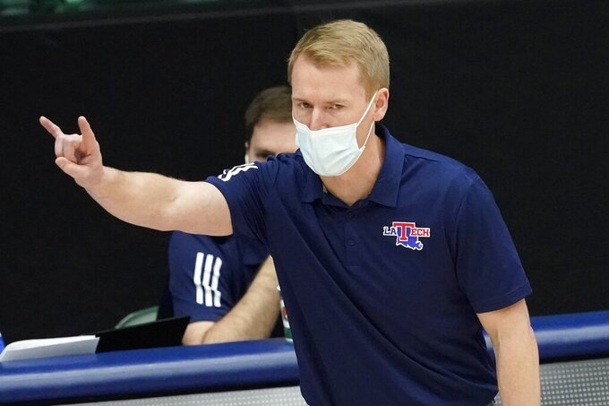 Louisiana Tech coach Eric Konkol signals to player during the first half of an NCAA college basketball game against Western Kentucky in the quarterfinals of the NIT, Thursday, March 25, 2021, in Frisco, Texas. (AP Photo/Tony Gutierrez)