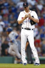 Boston Red Sox's Chris Sale stands on the field after giving up a solo home run to Los Angeles Dodgers' Justin Turner, left, during the third inning of a baseball game in Boston, Saturday, July 13, 2019. (AP Photo/Michael Dwyer)
