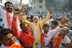 Supporters of Vishwa Hindu Parishad (VHP), or World Hindu Council, celebrate the Supreme Court's verdict outside the VHP office in Ahmadabad, India, Saturday, Nov. 9, 2019. India's Supreme Court has ruled in favor of a Hindu temple on a disputed religious ground and ordered that alternative land be given to Muslims. The dispute over land ownership has been one of the country's most contentious issues. (AP Photo/Ajit Solanki)