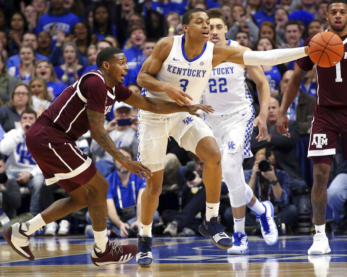 Kentucky's Keldon Johnson (3) drives while defended by Texas A&M's Jay Jay Chandler, left, during the first half of an NCAA college basketball game in Lexington, Ky., Tuesday, Jan. 8, 2019. (AP Photo/James Crisp)