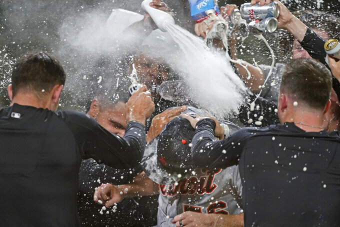 Detroit Tigers starting pitcher Spencer Turnbull (56) is showered with beer and powder by teammates after Turnbull threw a no-hitter in the team's baseball game against the Seattle Mariners, Tuesday, May 18, 2021, in Seattle. The Tigers won 5-0. (AP Photo/Ted S. Warren)