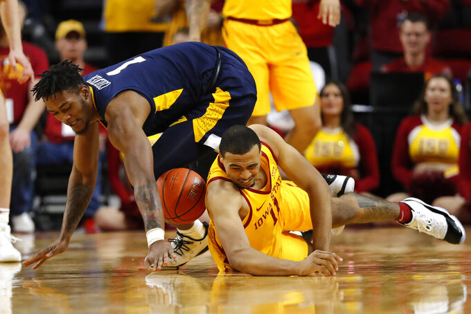 West Virginia forward Derek Culver, left, fights for a loose ball with Iowa State guard Talen Horton-Tucker during the second half of an NCAA college basketball game Wednesday, Jan. 30, 2019, in Ames, Iowa. (AP Photo/Charlie Neibergall)