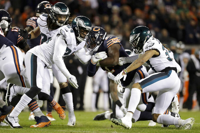 Chicago Bears running back Jordan Howard (24) is stopped by the Philadelphia Eagles defenders during the first half of an NFL wild-card playoff football game Sunday, Jan. 6, 2019, in Chicago. (AP Photo/Nam Y. Huh)