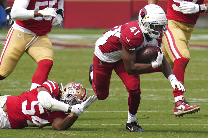 Arizona Cardinals running back Kenyan Drake (41) runs past San Francisco 49ers middle linebacker Fred Warner (54) during the first half of an NFL football game in Santa Clara, Calif., Sunday, Sept. 13, 2020. (AP Photo/Tony Avelar)
