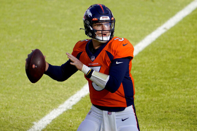 Denver Broncos quarterback Drew Lock (3) throws against the Los Angeles Chargers during the first half of an NFL football game, Sunday, Nov. 1, 2020, in Denver. (AP Photo/Jack Dempsey)