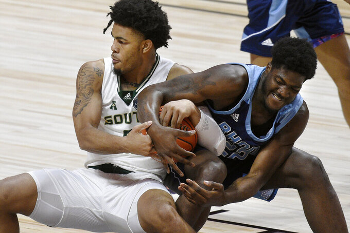 South Florida's David Collins, left, and Rhode Island's Makhel Mitchell vie for control of the ball during the first half of an NCAA college basketball game Saturday, Nov. 28, 2020, in Uncasville, Conn. (AP Photo/Jessica Hill)