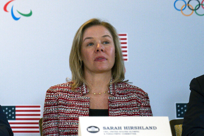 FILE - In this Feb. 18, 2020, file photo, United States Olympic and Paralympic Committee CEO Sarah Hirshland listens as President Donald Trump speaks during a briefing with the U.S. Olympic and Paralympic Committee and Los Angeles 2028 organizers in Beverly Hills, Calif. The U.S. Olympic and Paralympic Committee is signaling willingness to challenge longstanding IOC rules restricting protests at the Olympics, while also facing backlash from some of its own athletes for moves viewed by some as not being driven by sufficient athlete input. (AP Photo/Evan Vucci, File)