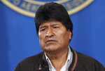 """Bolivia's President Evo Morales speaks during a press conference at the military airport in El Alto, Bolivia, Saturday, Nov. 9, 2019.  Police in three of the most important cities of Bolivia retreated to their barracks asking for the resignation of Morales, who stressed """"a coup d'etat in process"""" and called for a dialogue with the opposition to pacify the country after weeks of protests against the results of the presidential elections. (AP Photo/Juan Karita)"""