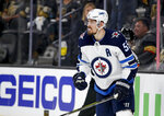 Winnipeg Jets center Mark Scheifele celebrates after scoring against the Vegas Golden Knights during the third period of Game 3 of the NHL hockey playoffs Western Conference finals Wednesday, May 16, 2018, in Las Vegas. (AP Photo/John Locher)
